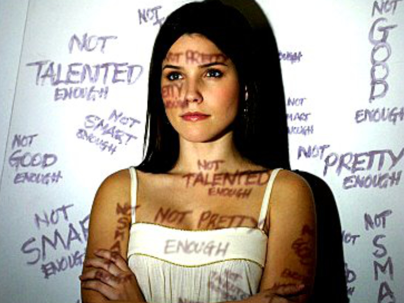 words projected over woman